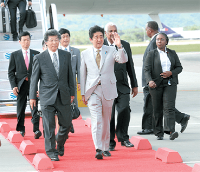Japan's Prime Minister Shinzo Abe shortly after his arrival at Piarco International Airport's south terminal yesterday where he was greeted by Minister of Foreign Affairs Winston Dookeran and Ambassador  of Japan Yoshimasa Tezuka. (Picture by Shirley Bahadur.)