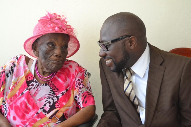 Member of Parliament for St George South Dwight Sutherland greeting centenarian Marguerita Jones.