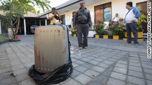 The body of Sheila von Weise Mack, 62, was stuffed in this hard-sided gray suitcase.