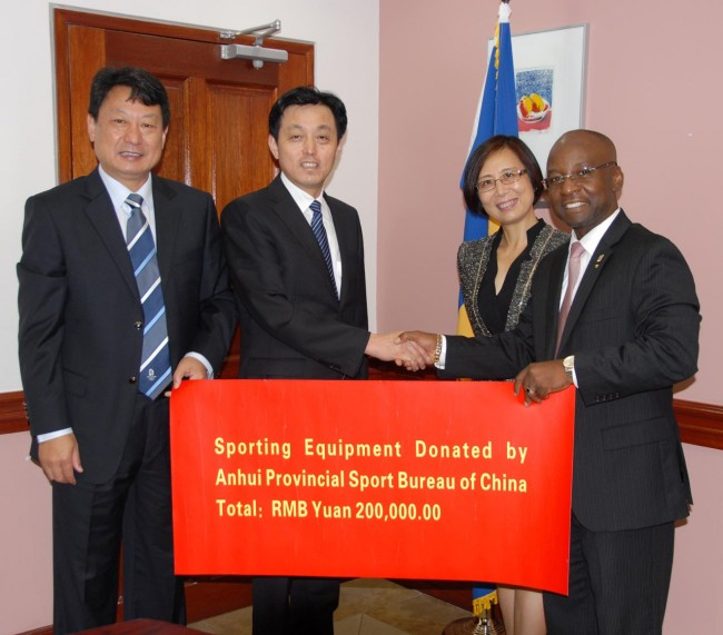 From left, Gao Weiling, consul of Anhui Provincial Sports Bureau, Vice-Governor of the Anhui Province Xie Guangxiang, and Ambassador of the People's Republic of China to Barbados, Wang Ke, presenting the sports equipment to Minister of Culture, Sports and Youth Stephen Lashley.
