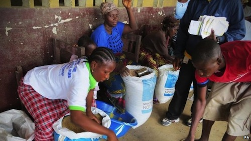Food aid is delivered to some of the thousands of people affected by Ebola in Liberia