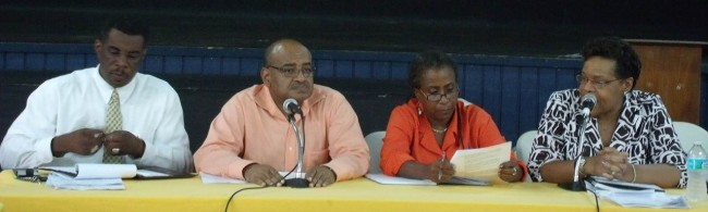 NCF officials at last night's Talk Calypso meeting from left, manager NCF administration, Wayne Webster; CEO of the NCF Cranston Browne; senior business development officer, Allison Sealy-Smith; and sponsor's representative Margaret Altman-Goddard.