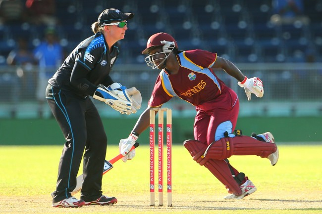 Deandra Dottin makes her ground as wicketkeeper Rachel Priest awaits the return of the ball from the deep.