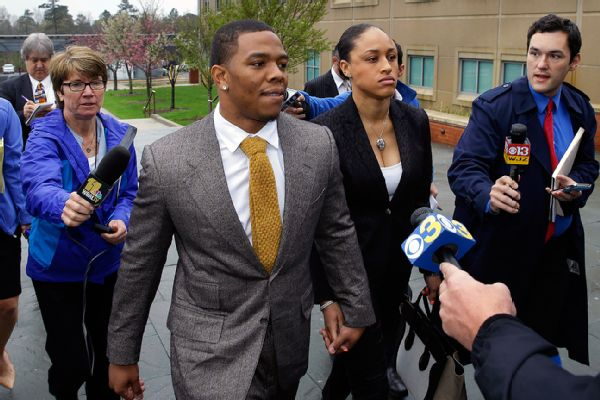 Ray Rice holds hands with his wife, Janay Palmer, as they arrive at the courthouse Thursday, May 1.