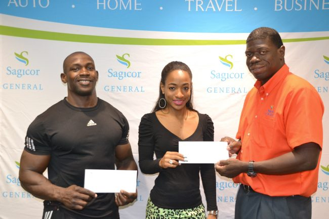 Stevenson Belle (left) and bikini fitness competitor Melissa Burrowes are presented with support packages from Sagicor General's assistant vice-president of marketing, Roger Spencer.