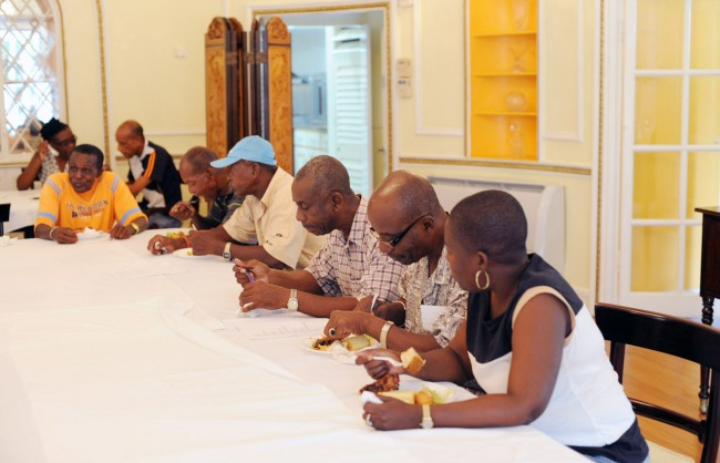 McDonald Thornhill (at right) participating in a meal with his former co-workers at Ilaro Court at a function held in his honour.
