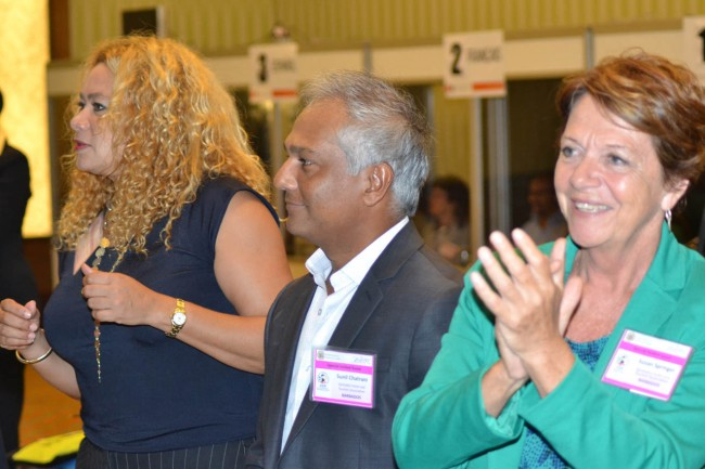 Tourism officials (left to right) Petra Roach, interim CEO of the Barbados Tourism Marketing Inc.; president of the Barbados Hotel and Tourism Authority (BHTA) Sunil Chatrani; and executive vice president of the BHTA, Sue Springer, enjoyed the entertainment at the opening ceremony of the conference.