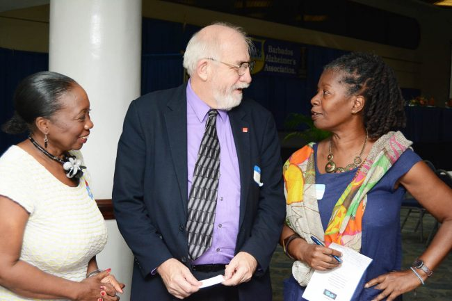 Policy adviser with Alzheimer's Disease International, Michael Splaine (centre), having an engaging conversation with member of the Barbados Alzheimer's Association, Sharon Welch (right), as the association's president Pamelia Brereton looks on.