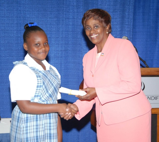 Cherish Samuel of Springer Memorial School, who placed second in the juniors at the local level of the competition, receiving her certificate from manager ofmarket development and public relations at the BarbadosPortInc., Freida Nicholls.