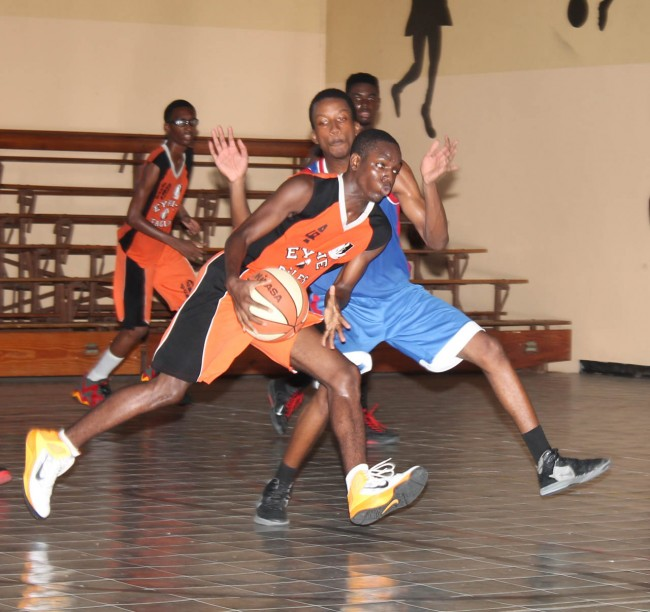 BCC's danger man Anderson Gittens (with ball) powering his way to the basket.