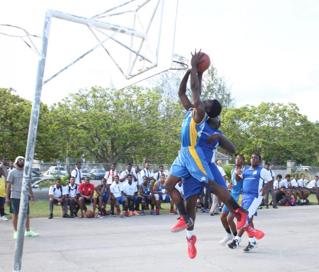 Combermere's Kadeem Brathwaite makes a spectacular move to the basket while defended by The Lodge School player. (Pictures by Marissa Lindsay).