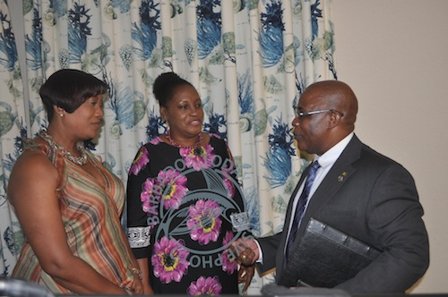 Principal of the St Christopher's Primary School Cheryl Sargeant (left) and principal of St Bartholomew's Primary Hyacinth Harris having a chat with Dr Lowe at yesterday's launch