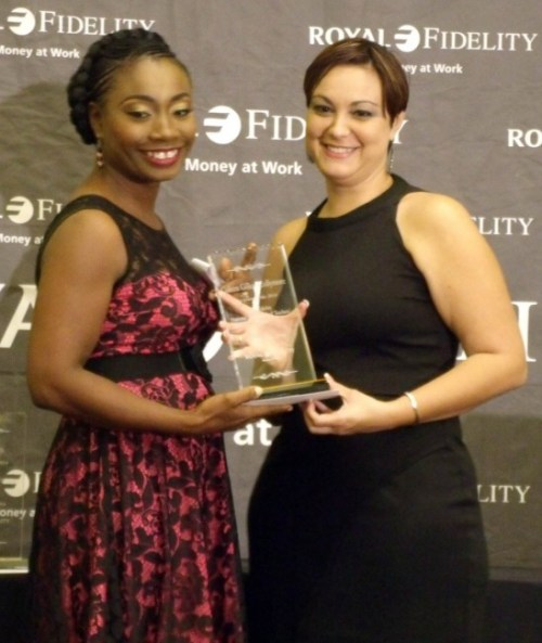 Coleen Gilkes-Collymore (left) is all smiles as she accepts her award from Nunes.