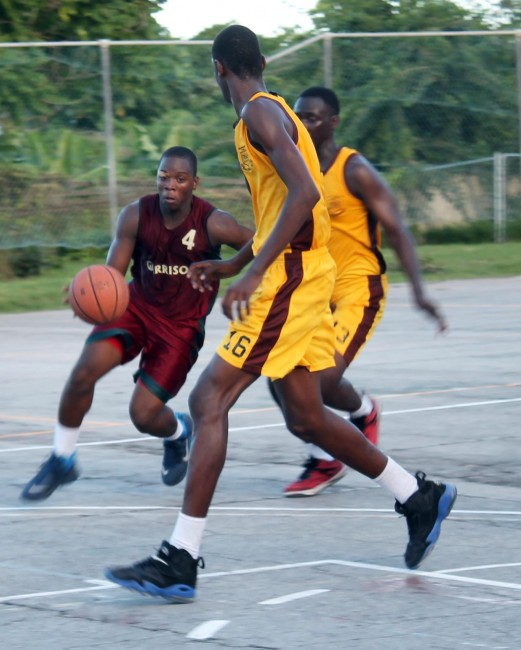 Graydon Sealy guard Andrew Ifill (with ball)  making a move towards the basket.