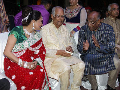 Prime Minister Kamla Persad Bissessar chats with president of the National Council on Indian Culture (NCIC) Deokinanan Sharma, centre, and Minister of Works and Infrastructure Dr Surujrattan Rambachan at the closing ceremony of the Divali Nagar, Chaguanas, on Wednesday night.