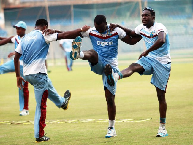 West Indies players (from left) Leon Johnson, Kemar Roach and Jerome Taylor train ahead of tomorrow's ODI.