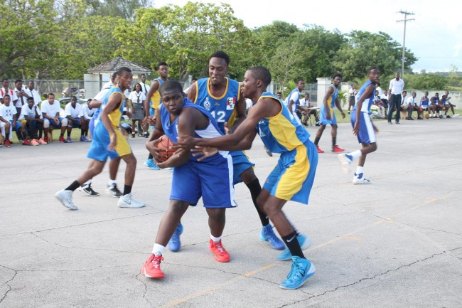 The Lodge School's burly center Alex Branch (with ball) has his hands full with this Combermere double-team.