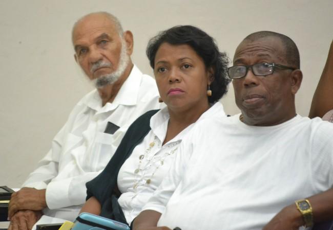 "Political Activist, Robert ""Bobby"" Clarke (left), representative of the Venezuelan Embassy Evelyn Gragirena (centre) and parliamentary representative for St Michael East, Trevor Prescod attended the function."