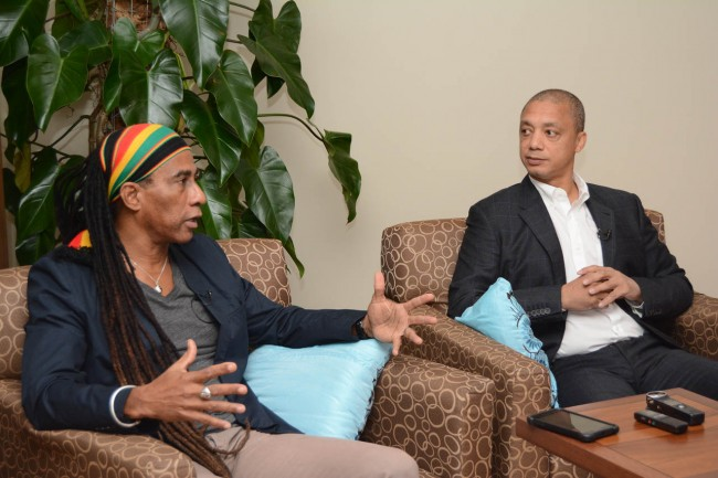 Cultural ambassador Adisa Aja Andwele (left) making a point during the press conference as Michael Aikin, managing director of Spring, looks on.