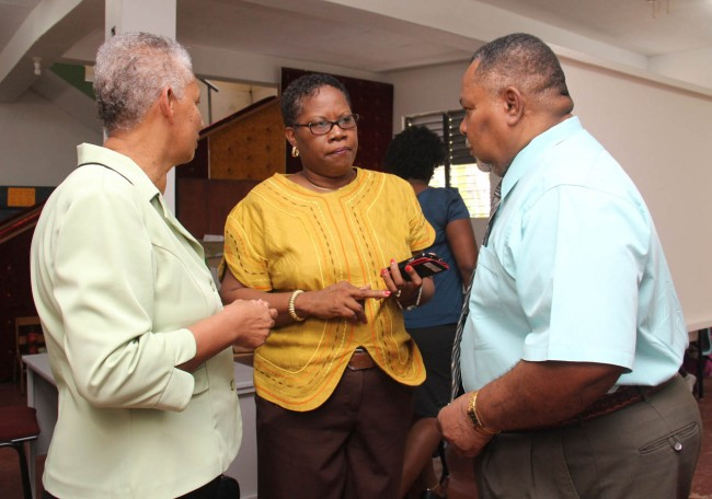 Chief Education Officer Laurie King (right), Education Officer Joy Adamson (centre) and principal of Grazettes Primary School Etwyn Bynoe having a discussion at Ebenezer Seventh Day Adventist Church where some of the students were relocated.