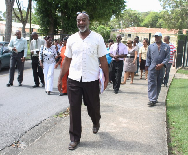 His tenure as General Secretary of the National Union of Public Workers is about to come to an end. However, union boss Dennis Clarke (front right) is not going out                without a fight.  Today, he was strongly backed up by workers as he warned management of the Barbados Community College that he was prepared for a fight to the very end.