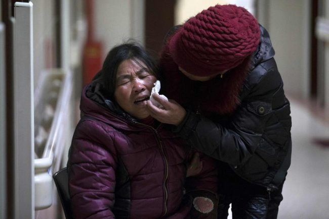 A woman cries at a hospital after a stampede occurred during a New Year's celebration on the Bund, central Shanghai.