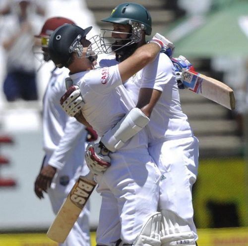 Dean Elgar (left) and captain Hashim Amla embrace after completing their 2-0 series win.