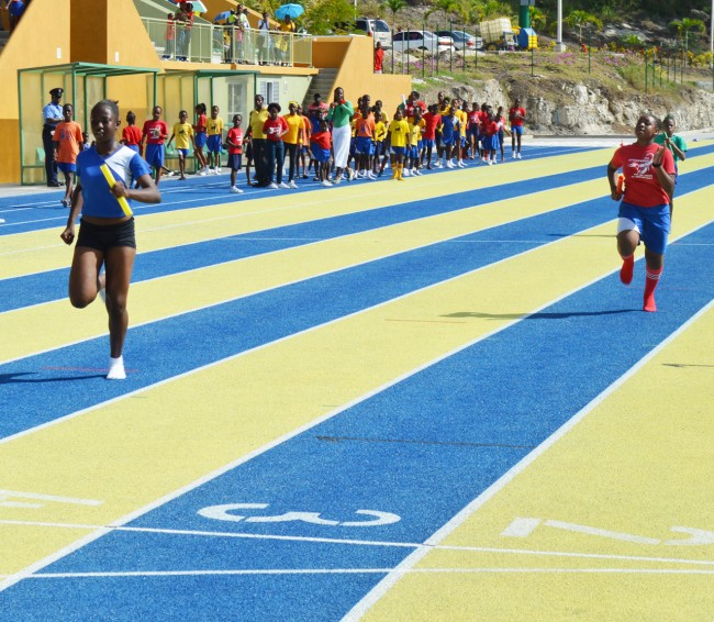 Destiny Watson of Gold (left) powering to victory over Red's Zipporah Durant in the girl's open 4x100 metre relay.