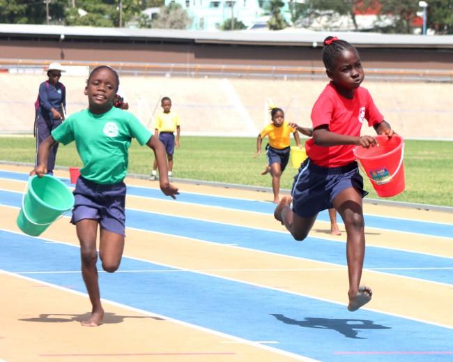 Donesha Barnett of Red House won the under-nine girls Bean Bag race ahead of Larrissa Brathwaite of Green House.