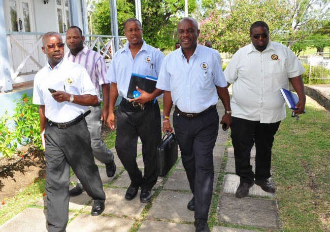 ACT NOW! Uncertainty hangs over the upcoming school term as the Barbados Union of Teachers (BUT) hints at taking action over unresolved problems at two schools. After a brief meeting at the Ministry of Education, BUT president Pedro Shepherd declared the union wanted action at the Parkinson Memorial and Alma Parris Memorial schools. Here, Shepherd (centre), BUT's vice president Richmark Cave (second from right), Public Relations Officer Dwane Goddard (right), General Secretary Herbert Gittens (left) and executive member Dwayne Greenidge (second from left) make their way into the meeting.