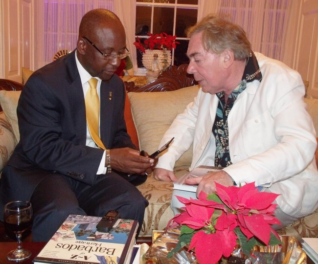 Minister of Culture Stephen Lashley (left) comparing notes with The Lord Lloyd-Webber.