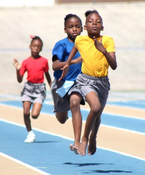Tyresha Clarke of St Giles Primary represented Yellow House with style and won the under-nine girls 100m.