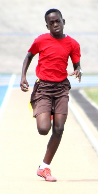 Under-13 boys division champion Tyreke Crawford of Red House impressively won the 200m.