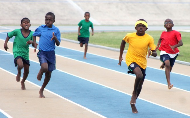 Victor ludorum Decarlo Straker of Yellow House slammed the field to win the under-11 boys 200m.
