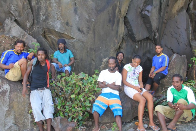 Villagers, including the men who fished the bodies out  of the water yesterday.