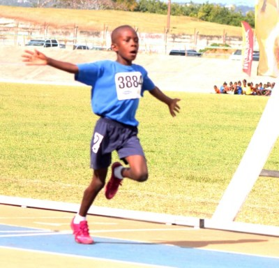 Shamari Adamson of St Albans Primary celebrates while crossing the finish line in the 150m.