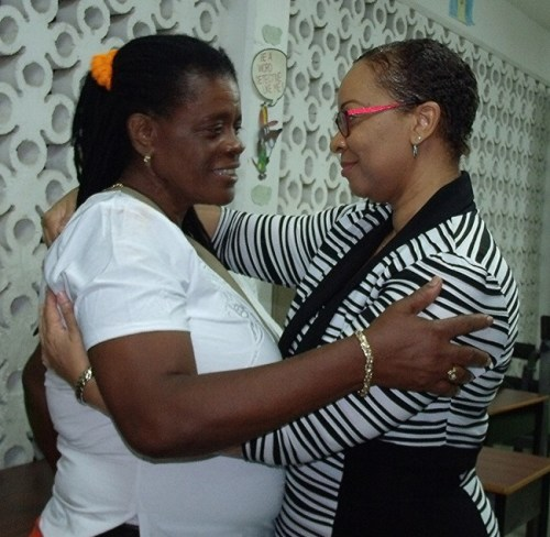 Christ Church West constituent Erla Horne sharing a hug with MP Dr Maria Agard.