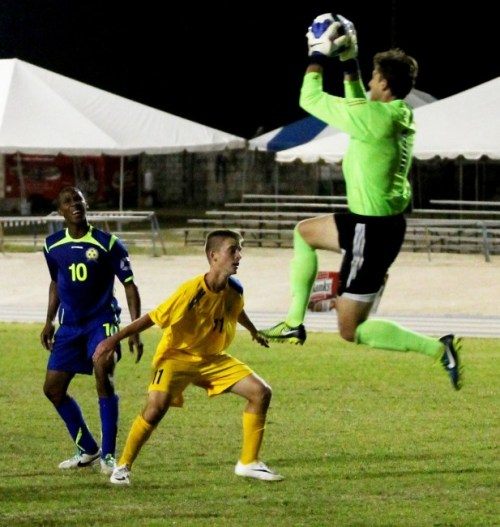 Barbados' Hadan Holligan (No. 10) on the attack once again but denied by great work from USVI goalkeeper Erik Mozzo (right).