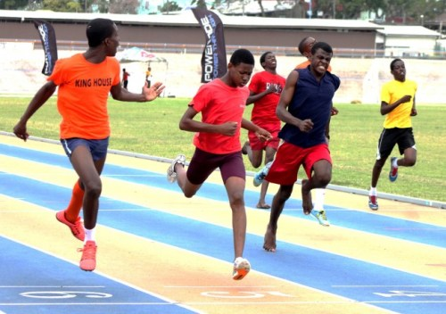 Jarion Johnson (left) of Orange House was so confident of winning the under-17 boys 200m that while approaching the finish line he called on the others to speed up.
