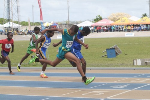 Jevon Burnett (left) just pipping Kristin Cummins on the line in the Under-13 boys 100 metres.