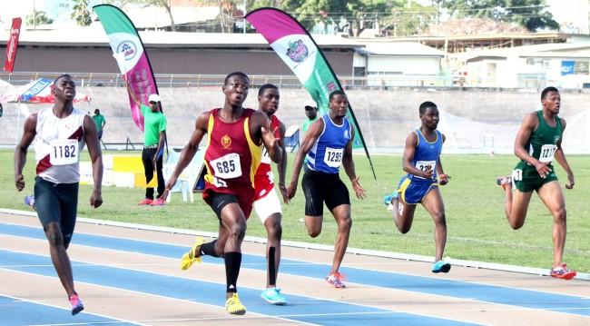 Mario Burke of Harrison College (second left) broke the under-20 boys 100m record.
