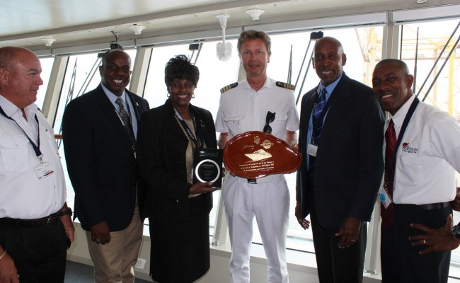 From left, Richard Alleyne, Freida Nicholls, Ian Stewart, Carl Gonsalves, Robert Moore,  and Captain Ulf Wolter of MS Europa 2.