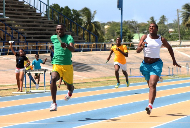 Reco Jordan of Barnett (left) won the 4x100m for his house in the under-20 boys division.