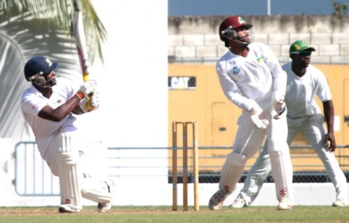 Shamarh Brooks swings to the boundary to bring up his maiden first-class century for Barbados.