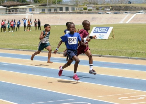 Shamari Addison (left) seen here edging Kevion Newton in the Under-9 80 metres was the star of the day.
