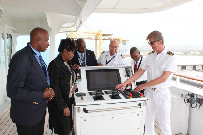 From left, Carl Gonsalves, assistant manager, marine services; Ian Stewart, terminal operations; Freida Nicholls, manager, market development, and public relations; Captain Ulf Wolter of MS Europa 2;  Harbour Master Richard Alleyne, manager, marine services; and Robert Moore, manager, marine Operations, of Platinum Port Agency Inc.