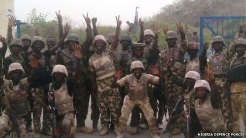 The capture of Gwoza was celebrated by Nigerian soldiers after the battle.