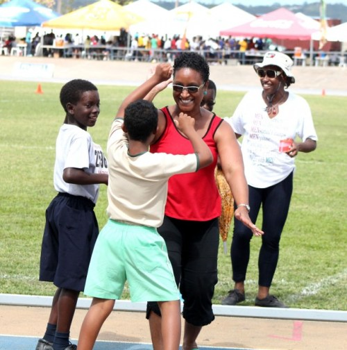 This excited mother could not contain her joy as she celebrates with her son who did not win but made it to the finish line in the 50m dash.