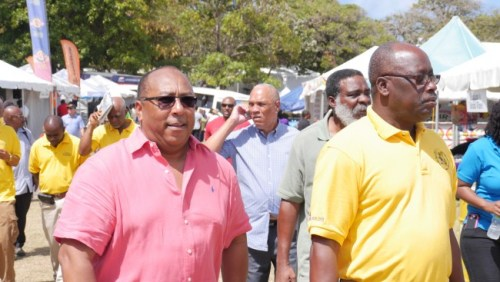 Ministry of Agriculture Dr David Estwick and chief executive officer of the Barbados Agricultural Society James Paul touring Agrofest.