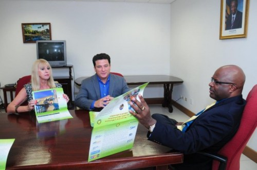 From left, Attorney General Adriel Brathwaite, calendar coordinator; Nicholas Mouttet, president of ANSA McAL and Janet Lewis, prison librarian discuss options to create greater visibility and sale of inmates' artwork.